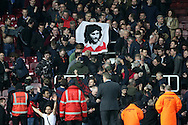 Manchester United fans hold a George Best banner after full time. The Emirates FA cup, 6th round replay match, West Ham Utd v Manchester Utd at the Boleyn Ground, Upton Park  in London on Wednesday 13th April 2016.<br /> pic by John Patrick Fletcher, Andrew Orchard sports photography.