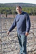 Christian Mocci Domaine de Mas de Martin, St Bauzille de Montmel. Gres de Montpellier. Languedoc. Owner winemaker. In the vineyard. France. Europe.