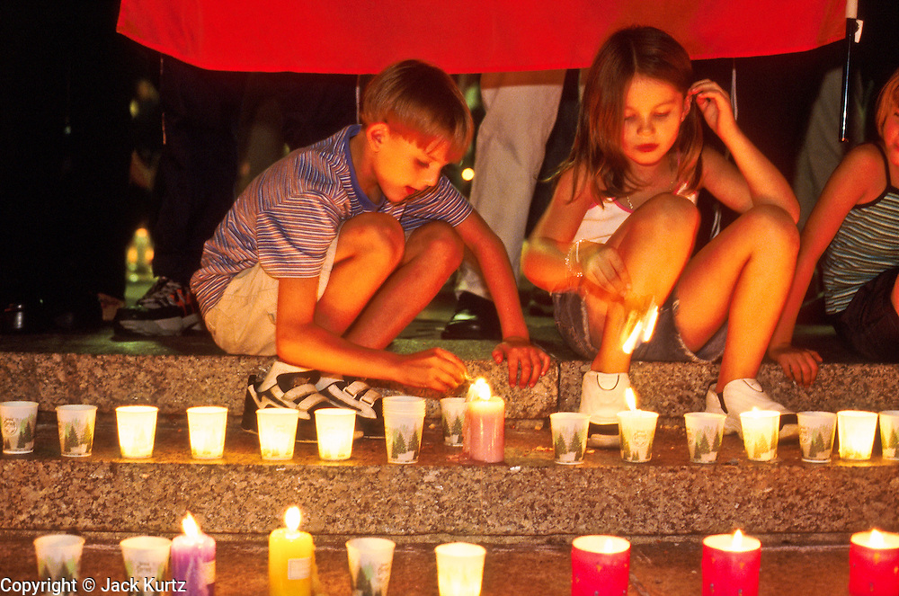 18 SEPTMEBER 2011 - NEW YORK, NY: Muslim children from Albania light candles at a memorial  in Union Square for people killed in the WTC attacks in New York City, Sept 18, 2001. More than 2,900 people were killed when terrorists, thought to be affiliated with Osama bin Laden, hijacked and crashed two passenger jets into the twin towers on the southern tip of Manhattan on Sept 11, 2001. Thousands of memorials for the dead and missing have been built in lower Manhattan, many of them in Union Square.   PHOTO BY JACK KURTZ