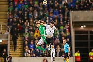 Northern Ireland defender Jamal Lewis and Estonia midfielder Mattias Käit clash in the air during the UEFA European 2020 Qualifier match between Northern Ireland and Estonia at National Football Stadium, Windsor Park, Northern Ireland on 21 March 2019.