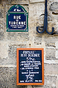 Street sign and Petit Dejeuner brasserie board, rue de Turenne, 4th arondissement, Paris, France