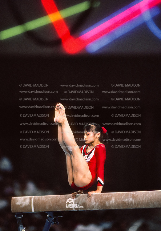 SEATTLE - JULY 1990:  Mari Kosuge of Japan performs on the balance beam during the gymnastics competition of the 1990 Goodwill Games held from July 20 - August 5, 1990.  The gymnastics venue was the Tacoma Dome in Tacoma, Washington.  (Photo by David Madison/Getty Images)