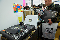 © Licensed to London News Pictures. 13/04/2019. LONDON, UK. A turntable plays as customers browse in Sounds of the Universe records shop. Analogue music fans visit independent record shops in Soho to celebrate vinyl music on the 12th Record Store Day.  Over 200 independent record shops across the UK come together annually to celebrate the unique culture of analogue music with special vinyl releases made exclusively for the day.  In 2018, sales of vinyl rose for the 11th consecutive year to 4.2 million units according to the British Phonographic Industry (BPI).  Photo credit: Stephen Chung/LNP