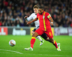 Wales Captain, Ashley Williams (Swansea city) battles for the ball with Scotland's Kris Commons (Celtic) - Photo mandatory by-line: Joe Meredith/JMP  - Tel: Mobile:07966 386802 12/10/2012 - Wales v Scotland - SPORT - FOOTBALL - World Cup Qualifier -  Cardiff   - Cardiff City Stadium -