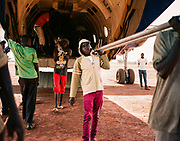 """YIDA, SOUTH SUDAN – JUNE 9, 2018: Aid is delivered by cargo plane to the Yida airstrip.<br /> <br /> Founded in 2011 by Samaritan's Purse, and strategically located near the border with Sudan to the north, the Yida """"host community"""" was originally established to provide refuge for for the thousands of Nuba fleeing persecution by the Sudan government in the nearby Nuba Mountains. Within three years, Yida had grown to a population of 75,000 – representing refugees from across the region. Two additional refugee camps, Adjuonthok and Pamir, were then created to disperse the steady influx of refugees fleeing conflict."""
