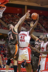 06 December 2008: Dinma Odiakosa hooks his shot to get past Erik Marschall and Otis Polk during a game where the  Illinois State University Redbirds extended their record to 8-0 with a 78-65 win over the Bowling Green Falcons on Doug Collins Court inside Redbird Arena on the campus of Illinois State University in Normal Illinois