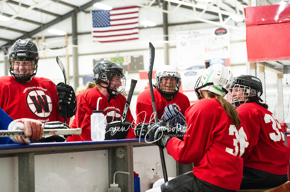 The Red team members Alli Caron, Lori Marsh, Lara Arsenault, Nancy Voorhis and Adele Champoux strategize on the bench after the second period during Tuesday evenings Lakes Region Womens Hockey Club at the Laconia Ice Arena.   (Karen Bobotas/for the Laconia Daily Sun)