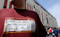 Photo: Daniel Hambury.<br /> Arsenal v Wigan Athletic. The Barclays Premiership. 07/05/2006.<br /> An Arsenal fan with a tee shirt showing the last match ticket ever played to be played at Highbury.