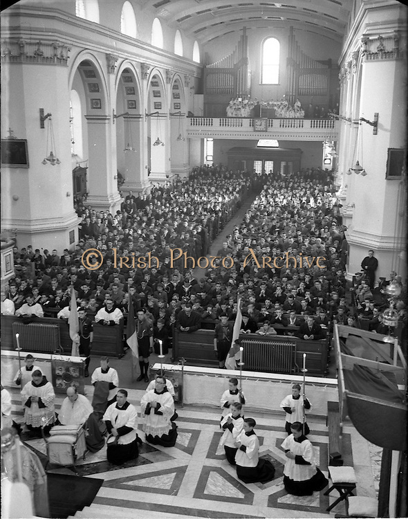 23/11/1952<br /> 11/23/1952<br /> 23 November 1952<br /> Franciscan Annual Youth Mass at Merchants Quay. View of the Mass showing the congregation. Archbishop John McQuaid can be seen in the lower left on the alter.