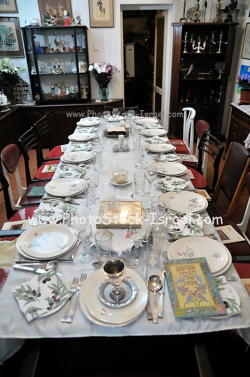 """Table set for a Jewish Festive meal on Passover (transliterated as Pesach or Pesah), also called chag HaMatzot - Festival of Matzot is a Jewish holiday beginning on the 15th day of Nisan, which falls in the early spring and commemorates the Exodus and freedom of the Israelites from ancient Egypt. Passover marks the """"birth"""" of the Jewish nation, as the Jews were freed from being slaves of Pharaoh and allowed to become servants of God instead."""