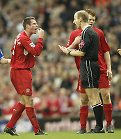 Fotball<br /> Premier League England 2004/2005<br /> Foto: SBI/Digitalsport<br /> 01.01.2005<br /> NORWAY ONLY<br /> <br /> Liverpool v Chelsea<br /> <br /> Liverpool's Jamie Carragher cant believe the referee has not blown for a penalty after a clear handball by Chelsea's Tiago<br /> John Arne Riise behind the ref