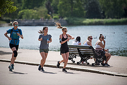 © Licensed to London News Pictures. 12/06/2021. London, UK. Members of the public exercise in the warm weather in Hyde Park in central London on another hot summer's day. This weekend is expected to be the hottest of the year so far. Photo credit: Ben Cawthra/LNP