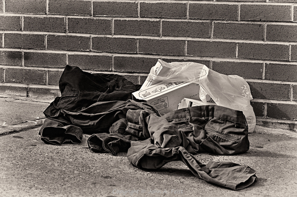You never know what you'll find on a New York street.  Here were a couple of empty pizza boxes along with some abandoned clothing.