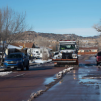 A City of Gallup snow plow makes its way around the Mossman neighborhood Wednesday afternoon in Gallup.