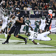UCF Knights wide receiver Gabriel Davis (13) scores a touchdown in front of South Florida Bulls cornerback Mazzi Wilkins (23) during a NCAA football game between the University of South Florida Bulls and the UCF Knights at Spectrum Stadium on Friday, November 24, 2017 in Orlando, Florida. (Alex Menendez via AP)