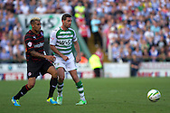 Jamie McAllister of Yeovil Town ® and Danny Williams of Reading during the Skybet championship match, Yeovil Town v Reading at Huish Park in Yeovil on Saturday 31st August 2013. <br /> Picture by Sophie Elbourn, Andrew Orchard sports photography,