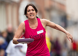 © Licensed to London News Pictures. 05/03/2019. Lichfield, Staffordshire, UK. The annual Shrove Tuesday pancake race taking place in Bore Street in the City Centre of Lichfield. Pictured, Jayne Whitehouse taking part in the ladies race. The event features races for men, women, children and those in fancy dress. The runners are supported by the voice of Town Crier Ken Knowles and the overall winner walks away with a brass and wooden Shrove Tuesday trophy. Photo credit: Dave Warren/LNP