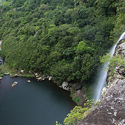 Tamarin Falls or Seven Falls, a seven layer waterfall hidden behind some sugarcane fields. It is one of the island's few remaining pristine areas, but it is slated for tourism development in the coming years.