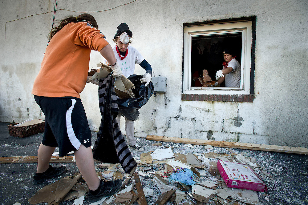 Superstorm-.Britney Valli and her brother Joey throw away damaged belongings from inside their home that was severely affected by Superstorm Sandy in Union Beach, N.J. November 3, 2012.