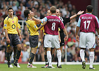 Photo: Paul Thomas.<br /> West Ham United v Arsenal. The Barclays Premiership. 24/09/2005.<br /> <br /> West Ham captain teddy Sheringham lashes out at Francesc Fabregas as referee Mike dean turns down a West Ham hand ball appeal.