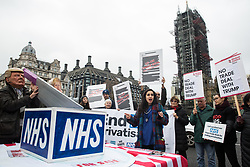 London, UK. 25 November, 2019. NHS doctor Sonia Adesara addresses campaigners from Keep Our NHS Public, Health Campaigns Together, We Own It and Global Justice Now at a protest in Parliament Square to call on Prime Minister Boris Johnson to end privatisation of healthcare in the National Health Service (NHS).