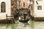 """VENICE, ITALY - 28th FEBRUARY/01st MARCH 2018<br /> A gondoler sails a small canal during a snowfall in Venice, Italy. A blast of freezing weather called the """"Beast from the East"""" has gripped most of Europe in the middle of winter of 2018, and in Venice A snowfall has covered the city with white, making it fascinating and poetic for citizen and tourists.   © Simone Padovani / Awakening"""