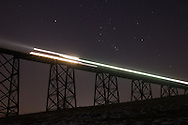 Salisbury Mills, NY - The constellation Orion rises over the Moodna Viaduct as a commuter train crosses the railroad bridge at twilight on Thursday, Jan. 14, 2010.