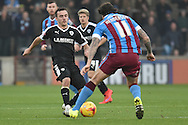 Darius Henderson of Scunthorpe United and Josh Scowen of Barnsley FC during the Sky Bet League 1 match between Scunthorpe United and Barnsley at Glanford Park, Scunthorpe, England on 31 October 2015. Photo by Ian Lyall.