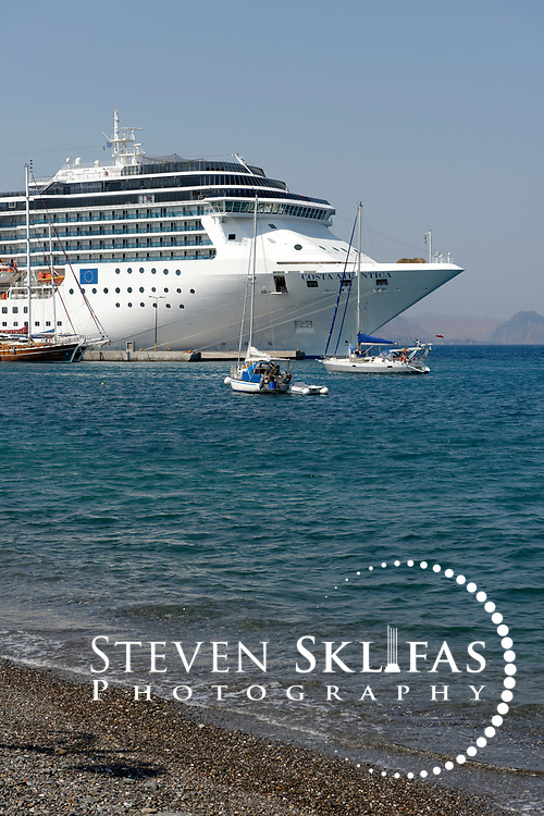 The cruise ship Costa Atlantica anchored in the harbor of Kos town, the capital of the Greek island of Kos. Kos is part of the Dodecanese island group and birthplace of the ancient physician and father of medicine, Hippocrates. Please contact Steven Sklifas for more information.