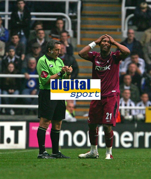 Photo: Andrew Unwin.<br /> Newcastle United v Bolton Wanderers. The Barclays Premiership. 15/10/2006.<br /> Bolton's El-Hadji Diouf (R) cannot believe it as he too is shown the yellow card by the referee, Alan Wiley (L).