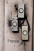 """Doorbells with the word """"press"""" written on in a London Street"""