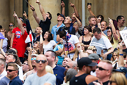 "Far right demonstrators scream abuse at a BBC camera crew on top of the broadcaster's headquarters, call in the paedophiles among other insults as several hundred far right protesters in central London demand the release of ""political prisoner"" right wing talisman Stephen Yaxley-Lennon  - also known as Tommy Robinson, who was imprisoned for contempt of court. London, August 03 2019."