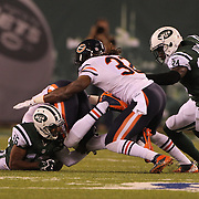 Jalen Saunders, New York Jets, fumbles a kick off return giving possession to the Chicago Bears  during the New York Jets Vs Chicago Bears, NFL regular season game at MetLife Stadium, East Rutherford, NJ, USA. 22nd September 2014. Photo Tim Clayton for the New York Times