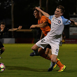 BRISBANE, AUSTRALIA - DECEMBER 3: Connor Metcalfe of the City is fouled by Nathan Konstandopoulos of the Roar during the round 4 Foxtel National Youth League match between the Brisbane Roar and Melbourne City at AJ Kelly Field on December 3, 2016 in Brisbane, Australia. (Photo by Patrick Kearney/Brisbane Roar)