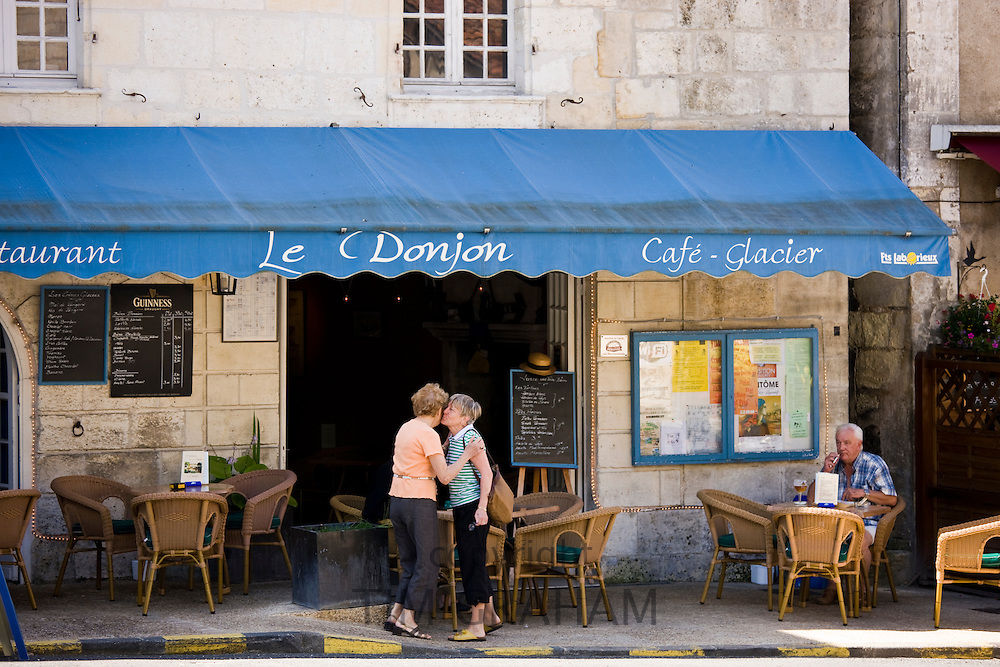 French greeting in quaint town of Bourdeilles popular as a tourist destination near Brantome North Dordogne, France