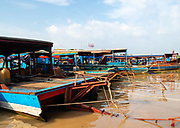 Boats are tied up, waiting for tourists to be transported to the floating village of Kampong Phluk, Cambodia..