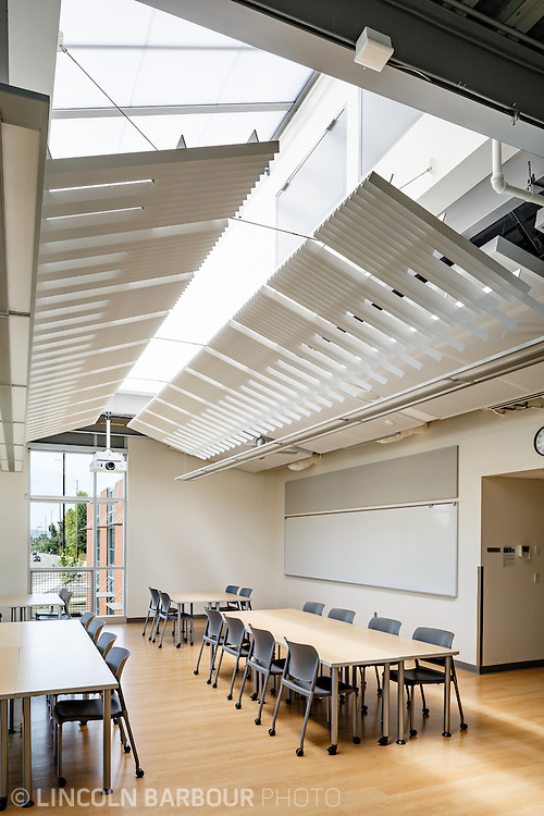 An empty work space filled with plenty of natural light coming through large skylights in this particular room inside the East Campus of PCC.