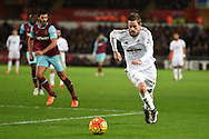 Gylfi Sigurdsson of Swansea city ® in action. Barclays Premier league match, Swansea city v West Ham Utd at the Liberty Stadium in Swansea, South Wales  on Sunday 20th December 2015.<br /> pic by  Andrew Orchard, Andrew Orchard sports photography.