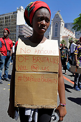 Wednesday 26 October 2016.<br /> Parliament, Cape Town,<br /> Western Cape,<br /> South Africa<br /> <br /> Fees Must Fall Protest March In Cape Town.<br /> <br /> A student wears a placard protesting against Police brutality outside Parliament in Cape Town.<br /> <br /> Students and supporters march to parliament in protest against higher education fees in South Africa on the 26th October 2016. The students are protesting against the fees for higher education. This protest is part of the #FeesMustFall campaign.<br /> <br /> Picture By: Mark Wessels/ RealTime Images.
