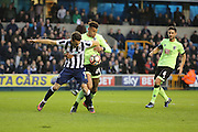 Millwall striker Lee Gregory (9) battles for possesion with Bournemouth Defender Tyrone Mings (26) during the The FA Cup 3rd round match between Millwall and Bournemouth at The Den, London, England on 7 January 2017. Photo by Matthew Redman.