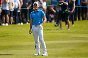 English golf professional Danny Willett  sees the funny side to his shot during the BMW PGA Championship at the Wentworth Club, Virginia Water, United Kingdom on 28 May 2016. Photo by Simon Davies.