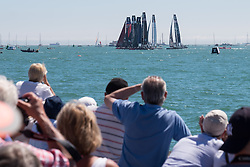 © Licensed to London News Pictures. 23/07/2016. Southsea, United Kingdom.  Spectators watching the first day of racing for the America's Cup World Series (ACWS) in Portsmouth this weekend, 22nd-24th July 2016. British Olympic sailing legend, Sir Ben Ainslie, is leading his all-British team, Land Rover BAR, against other teams in a battle to qualify for a place in the two team America's Cup final, to be held in Bermuda in 2017. Photo credit: Rob Arnold/LNP