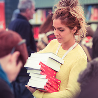 A young woman intern at work in the bookshop at The Hay Festival of Literature and the Arts, Hay on Wye, Powys, Wales UK, June 01 2016<br /> <br /> Picture by Keith Morris/Writer Pictures