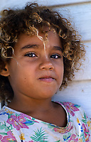 BARACOA, CUBA - CIRCA JANUARY 2020: Portrait of Cuban girl in the area around Bahia de Mata, a village close to Baracoa in Cuba.