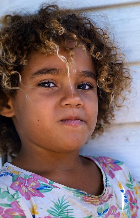 BARACOA, CUBA - CIRCA JANUARY 2020: Portrait of Cuban girl in the area around Bahia de Mata, a village close to Baracoa in Cuba.