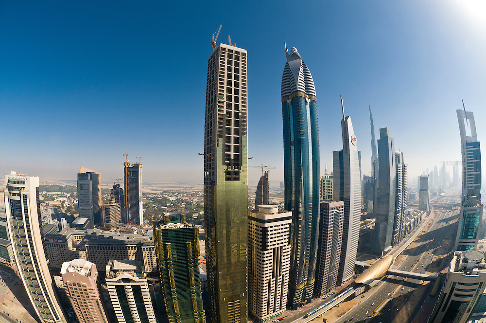 Overview of buildings on Sheik Zayed Road from the Sheraton Four Points Hotel (the Burj Khalifa, the tallest building in the world is in background), Dubai, United Arab Emirates