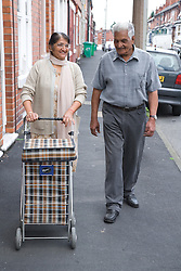 Older couple on their way to the shops,