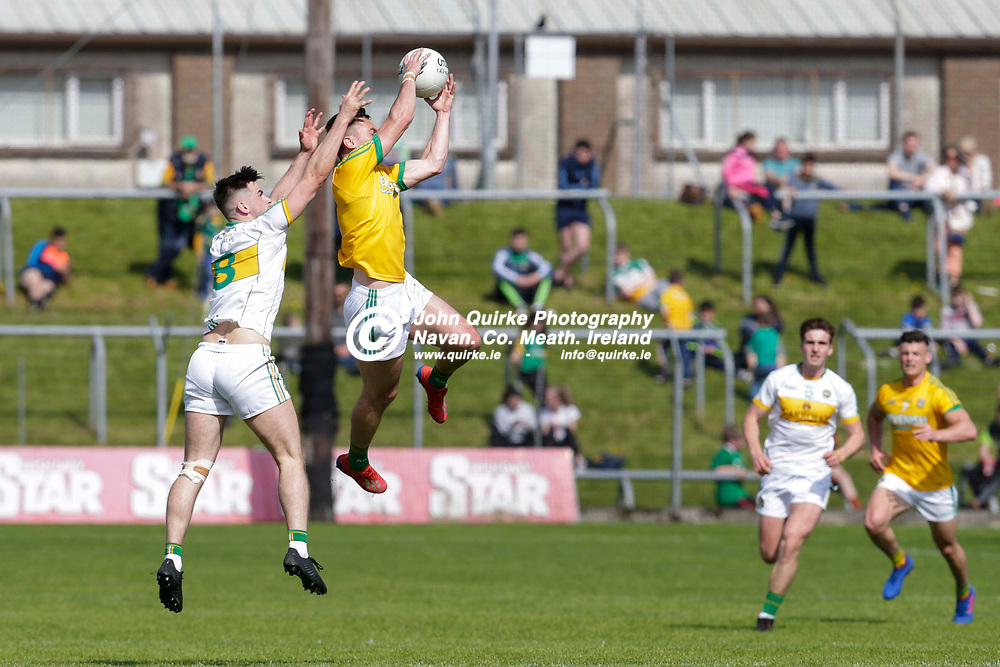 12/05/2019, Christy Ring Cup at Pairc Tailteann<br /> Meath vs London<br /> James McEntee (Meath) & Eoin Carroll (Offaly) <br /> Photo: David Mullen / www.quirke.ie ©John Quirke Photography, Unit 17, Blackcastle Shopping Cte. Navan. Co. Meath. 046-9079044 / 087-2579454.<br /> ISO: 250; Shutter: 1/1250; Aperture: 5.6; <br /> File Size: 7.3MB