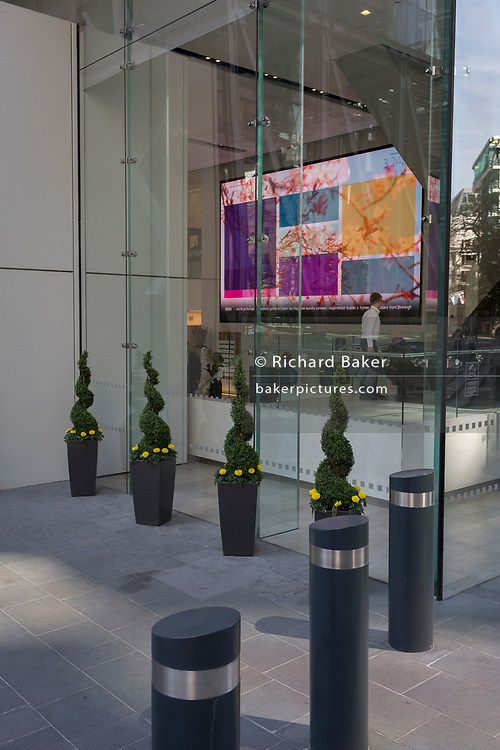 Architecture and info screens in the Aviva insurance building on the corner of Leadenhall and St Mary Axe in the City of London - the capital's financial district, on 6th June 2018, in London, England.