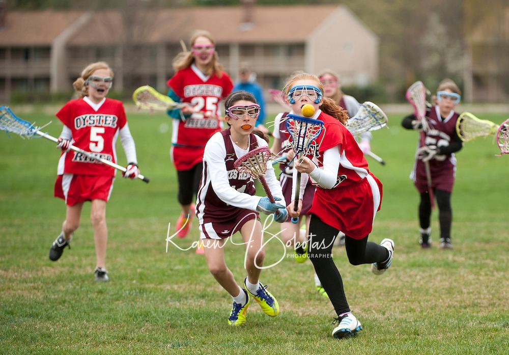 Lakes Region Lacrosse versus Oyster River U11 girls April 22, 2012.